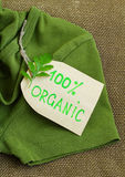 Green shirt  with organic clothes label Stock Photo