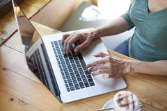 Green shirt woman typing keyboard Royalty Free Stock Image