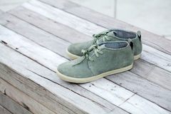 Green shoe on wood Stock Photography
