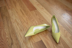 Green Shoes. On Wood Floor royalty free stock photos