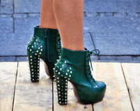 Interesting high heels. Green shoes on high heels Royalty Free Stock Image