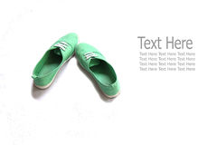 Green shoes. With text in white background royalty free stock images