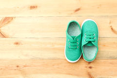 Green  shoes on wooden floor. Stock Images