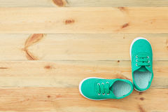 Green shoes on a wooden floor. Stock Image