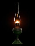 Shone oil lamp on the black. Royalty Free Stock Photos