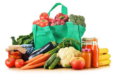 Green shopping bag with assorted grocery products Stock Photography
