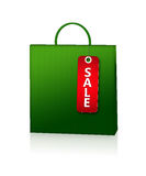 Green shopping bag and discount card  over white Stock Photography