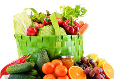 Green shopping bag with groceries on white Royalty Free Stock Photography