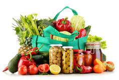 Green shopping bag with groceries on white Royalty Free Stock Image