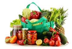 Green shopping bag with groceries on white Royalty Free Stock Images