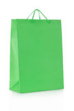 Green shopping bag in paper on white Royalty Free Stock Image