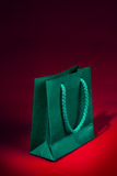 Green shopping bag on red royalty free stock photos