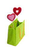 Green shopping bag with two red hearts isolated Stock Image