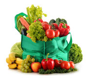 Green shopping bag with variety of fresh organic vegetables Royalty Free Stock Image