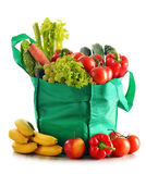 Green shopping bag with variety of fresh organic vegetables Stock Images