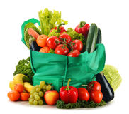 Green shopping bag with variety of fresh organic vegetables Royalty Free Stock Photo