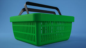 Green shopping basket blue background Royalty Free Stock Photos