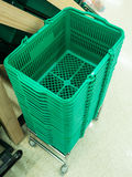 Green shopping baskets. This is green shopping baskets in supermarket Stock Images