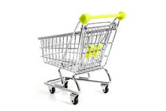 Green shopping cart on studio. Picture of green shopping cart on studio, isolated on white background Stock Image
