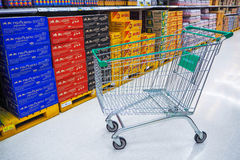 Green shopping cart in supermarket Stock Image
