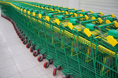 Green shopping carts in a row Stock Photography