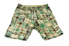 Green shorts. A pair of green shorts on a white background Stock Photo
