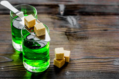 Green shots with sugar in spoon on table background space for text. Green shots with sugar cubes in spoon wooden bar table background space for text Royalty Free Stock Photo