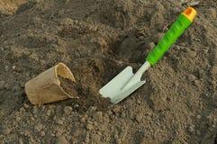 Green shovel and rake, garden gloves for seedlings Stock Images