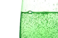 Green shower gel. Close-up of green shower gel on the white background Stock Image