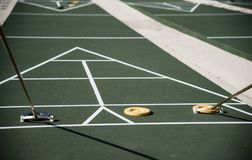 Shuffleboard court with game in progress royalty free stock photography
