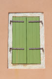 Green shutter,brown wall. Building with green shutter against brown wall,Fiskardo,Greece Stock Images