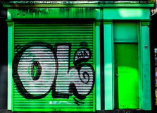 Green Shutter. Striking image of some simple graffiti on an old disused shop in the centre of Sheffield Royalty Free Stock Images