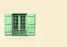 Green shuttered window with copy space Royalty Free Stock Photos