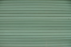 Green Shutters. An abstract closeup on green window shutters stock photos
