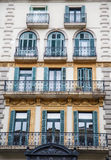 Green Shutters and Black Wrought Iron Balconies Stock Photography