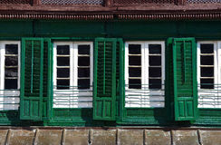 Green shutters in the Durbar square, Kathmandu, Nepal Royalty Free Stock Image