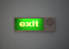 Green Sign of Exit, set on a wall Stock Photos