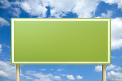 Green sign in front of a blue sky. High quality 3D render of a green sign in front of a blue sky (insert your own text Royalty Free Stock Image