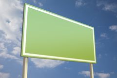 Green sign in front of a blue sky Stock Images