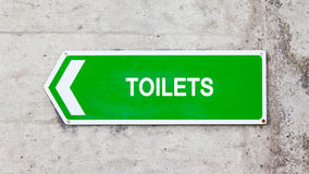 Green sign - Toilets Royalty Free Stock Photography