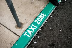 The green label and wording TAXI Zone on the floor Stock Image
