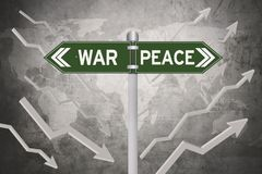 Green signboard with decision of war or peace. And world map in the background Stock Photo