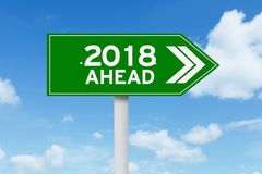 Green signboard with a text of 2018 ahead. Image of a green signboard with a text of 2018 ahead under blue sky Stock Photos