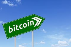 Green signpost with bitcoin word Stock Photo
