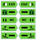 Green signs direction to the exit Stock Photos