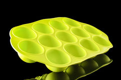 Green silicone ice cube tray on the black background Royalty Free Stock Photo