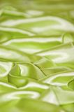 Green silk. Shiny green silk that can be used as a background or for texture Stock Photography
