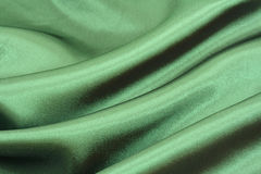 Green silk background. Green silk with waves background royalty free stock image