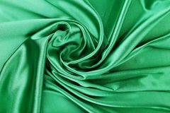 Green silk background. With some soft folds and highlights stock image