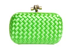 Green silk clutch isolated on white stock photo